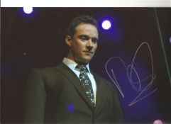 Russell Watson signed 12x8 colour photo of the singer performing on stage. Good Condition. All