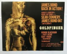 Goldfinger Shirley Eaton signed 10 x 8 inch colour photo of the movie poster; she has added screen