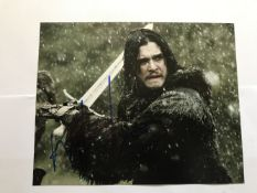 Game of Thrones Kit Harrington signed 10 x 8 inch colour photo, sword in hand. Good condition. All