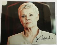James Bond Judi Dench signed 10 x 8 inch colour photo as M. Good condition. All signed pieces come