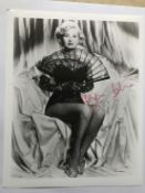 Za Za Gabor signed sexy 10 x 8 inch b/w photo. Good condition. All signed pieces come with a
