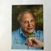 David Attenborough signed 12 x 8 inch colour photo with green frog on his hand. Good condition.