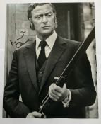 Michael Caine signed 12 x 8 inch b/w photo from Get Carter. Good condition. All signed pieces come