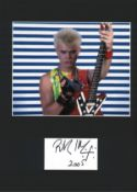 Billy Idol signature piece mounted below colour photo. Approx overall size 16x12. Good Condition.