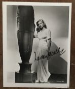 Lauren Bacall signed 10 x 8 inch b/w full length photo. Good Condition. All autographs come with a