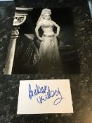 Barbara Windsor Signed 5x3 White Card With 10x8 Black And White Photo. Good condition. All