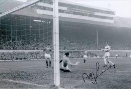 Autographed Bobby Lennox 12 X 8 Photo B/W, Depicting Lennox Shooting Past Rangers Goalkeeper