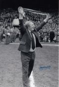 Autographed Tommy Docherty 12 X 8 Photo B/W, Depicting The Man United Manager Enjoying The