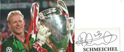 Peter Schmeichel Signed Page With Manchester United Photo. Good condition. All autographs come