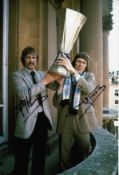 Autographed Ipswich 12 X 8 Photo Col, Depicting Frans Thijssen And Arnold Muhren Holding Aloft The