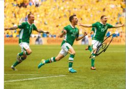 Robbie Brady Ireland Signed 16 x 12 inch football photo. Good condition. All autographs come with
