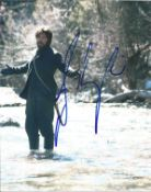 Josh Brolin signed 10x8 colour photo pictured in his role as Tom Chaney in 2010 western True Grit.