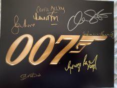 007 James Bond multiple signed 14x11 inch photo
