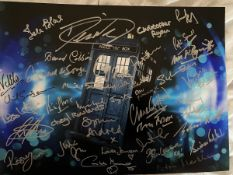 Doctor Who 14x11 inch photo signed by 40 actors and actresses