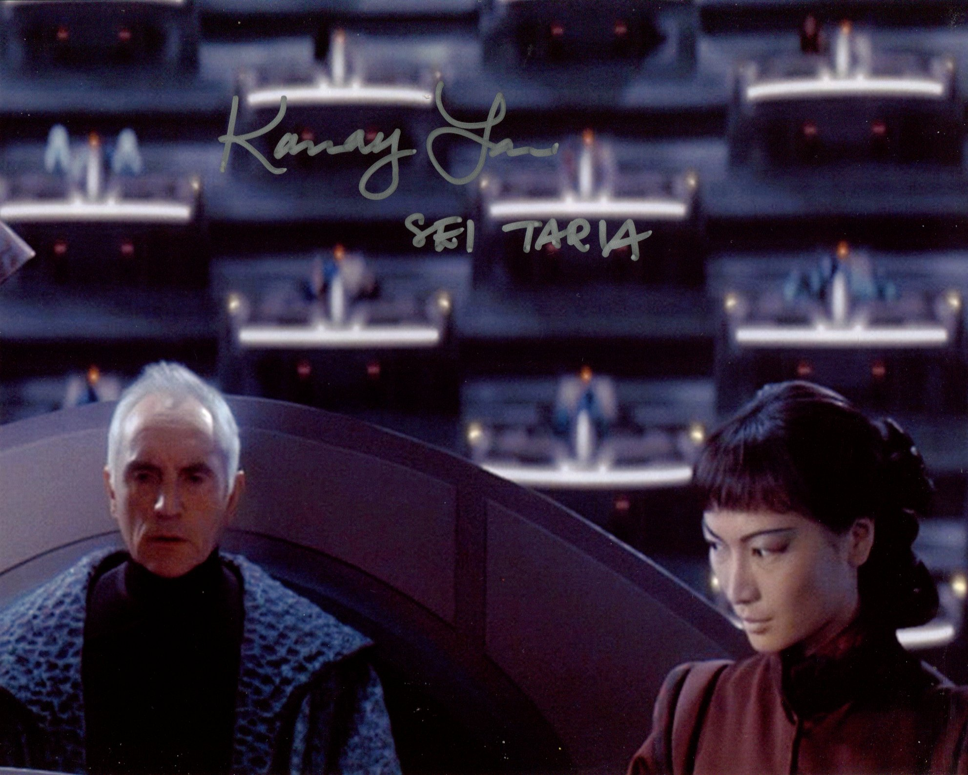 Star Wars 8x10 movie scene photo signed by actress Kamay Lau. Good condition. All autographs come