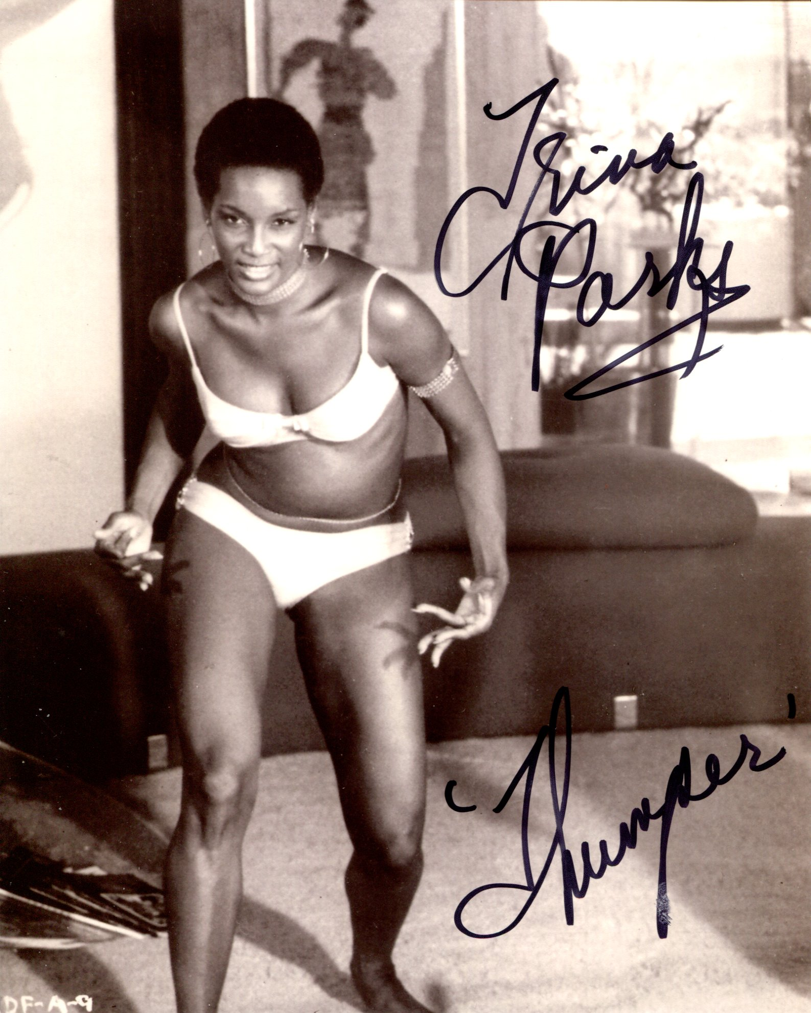 007 Bond girl Trina Parks as Thumper signed 8x10 photo from Diamonds are Forever. Good condition.