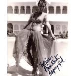 007 James Bond movie Octopussy 8x10 photo signed by actress Alison Worth. Good condition. All