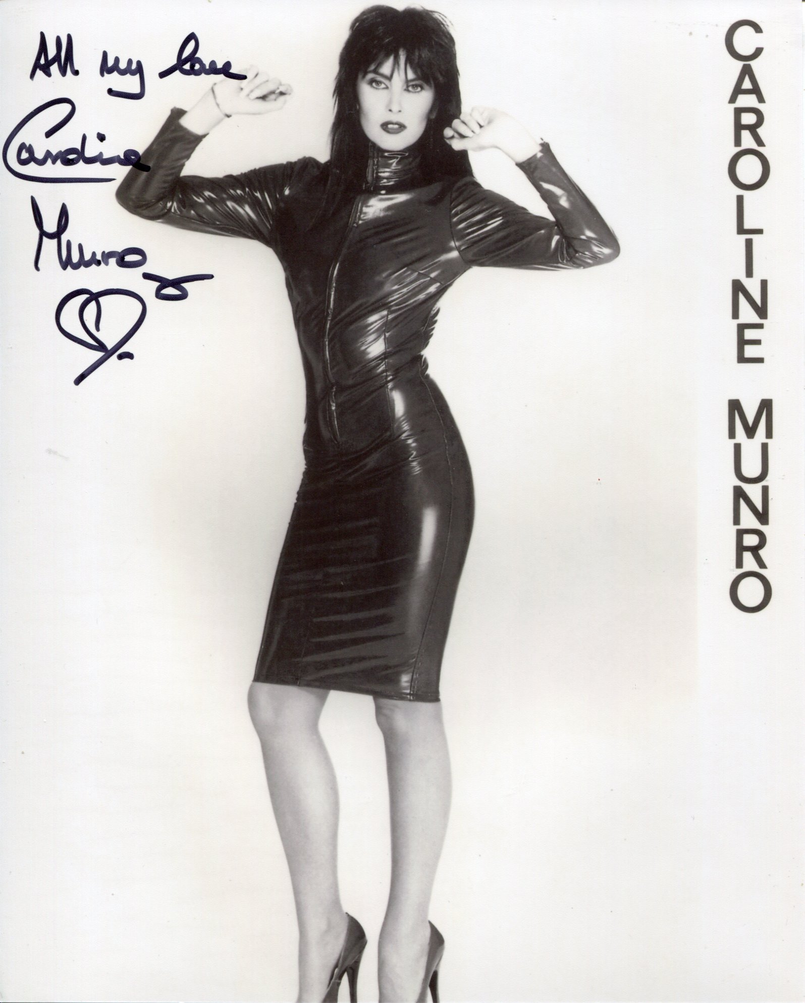 007 Bond girl. The Spy Who Loved Me actress Caroline Munro signed 8x10 sexy pose photo. Good