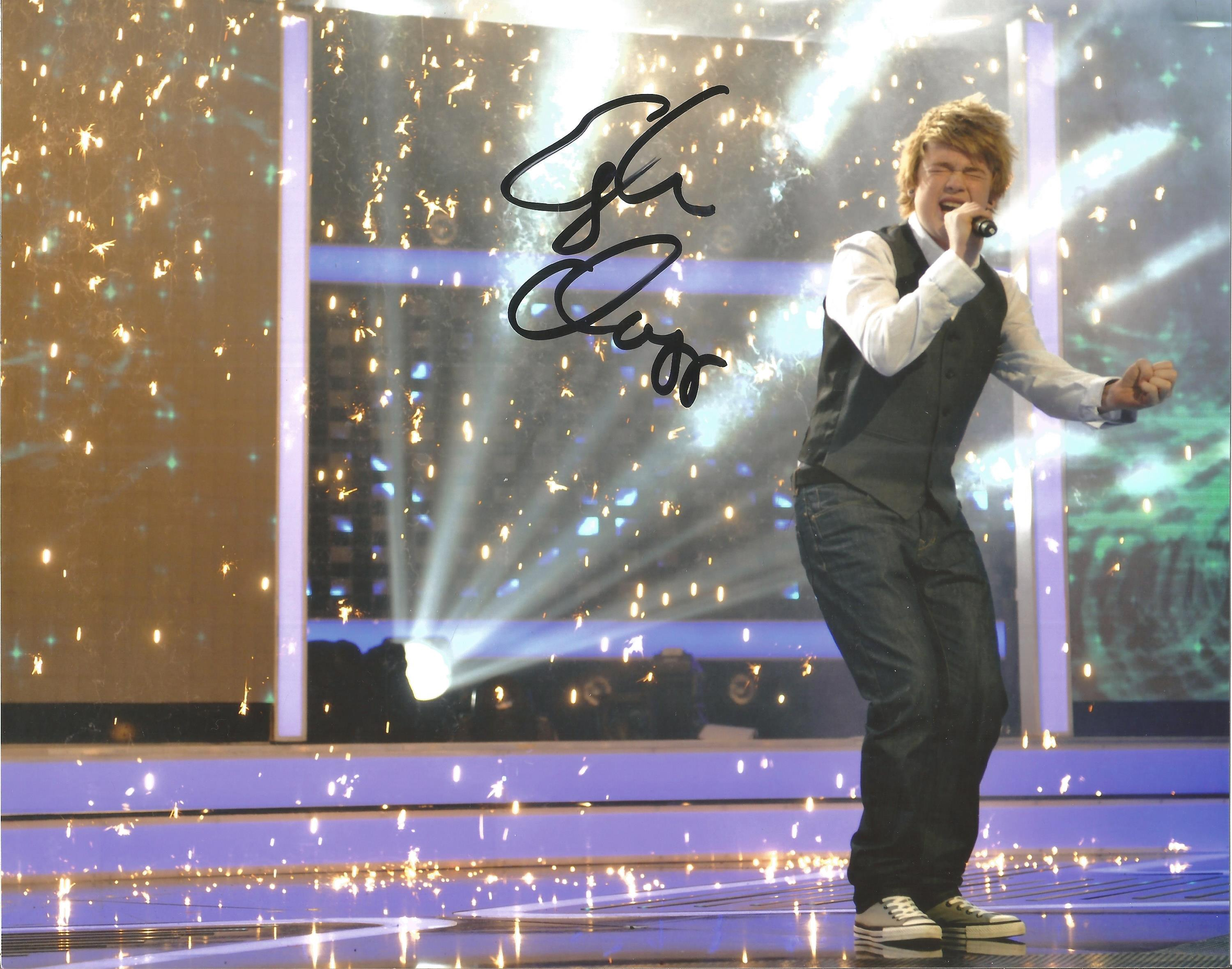 Eoghan Quigg Signed 10 x 8 inch music photo. Good Condition. All autographs come with a. Good