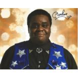 Clive Rowe 8x10 signed Dr Who colour photo. Clive Mark Rowe, MBE (born 27 March 1964) is a