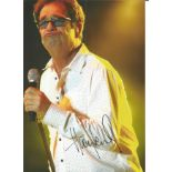 Huey Lewis signed 10x8 colour photo. Image taken during one of his many performances. Good