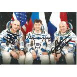 Donald Pettit American Soyuz Cosmonaut, Oleg Kononenko Soyuz Cosmonaut and Andre Kuipers Dutch Soyuz