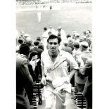 Freddie Truman. 8x10 photo signed by the late Fred Trueman, pictured leaving the field after