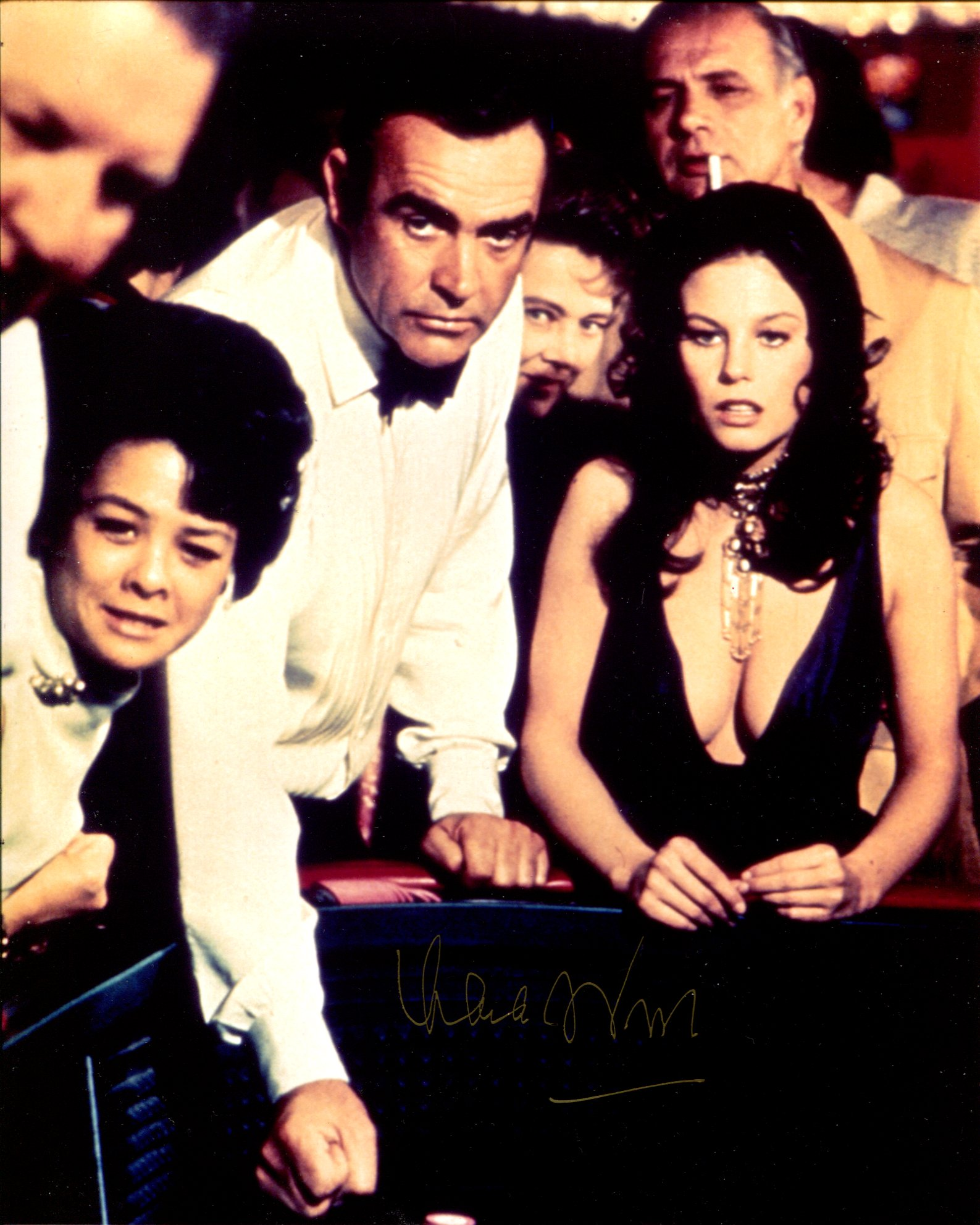 007 James Bond girl Lana wood signed 8x10 Diamonds Are Forever casino scene photo. Good condition.