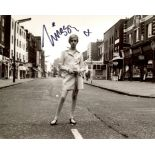 Twiggy. Stunning 8x10 photo signed by 1960's fashion icon Twiggy pictured in her absolute prime!.