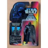 Star Wars, miniature action figure of Darth Vader, complete in the box. The packaging shows some