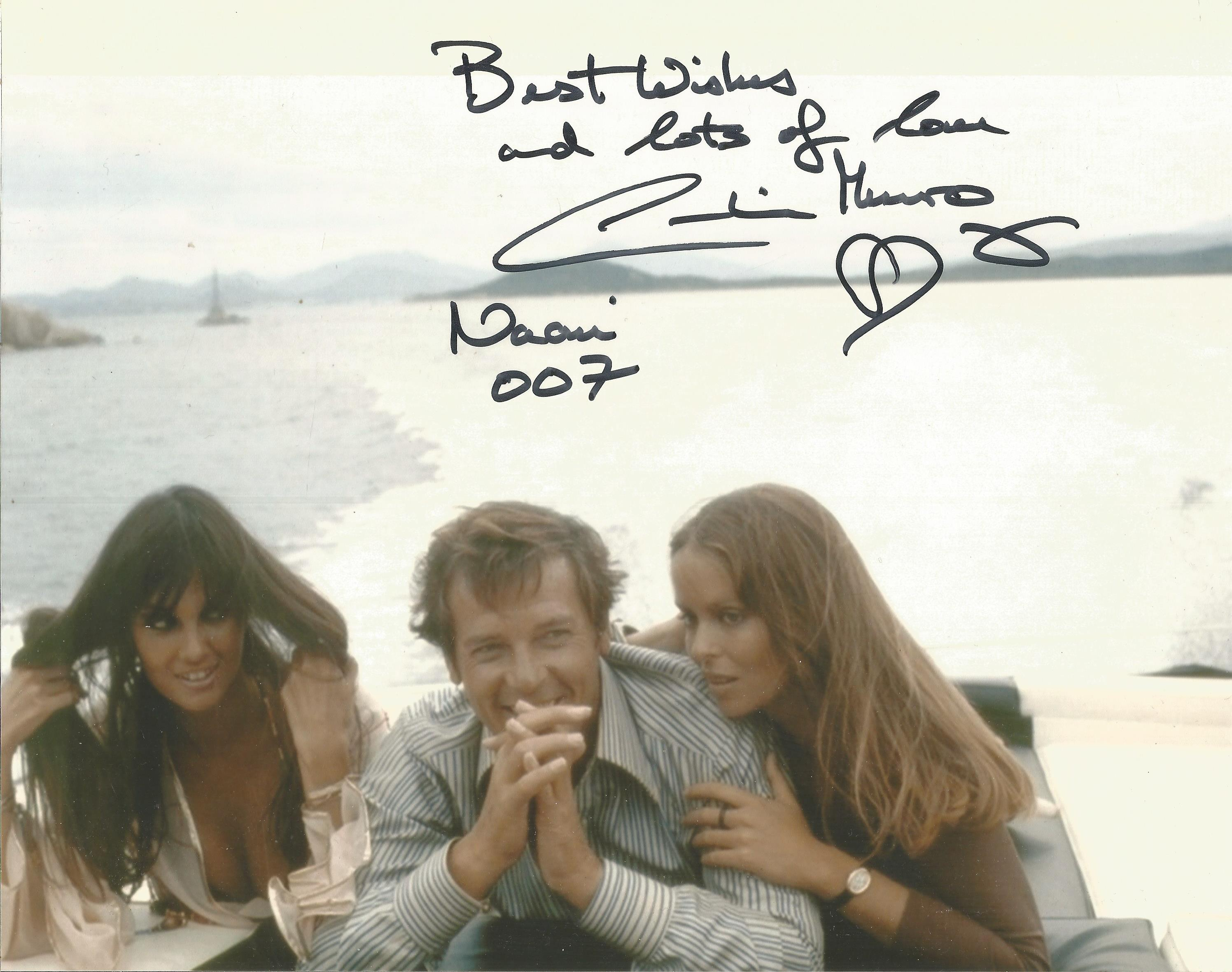 Caroline Munro as Naomi signed 10 x 8 inch colour James Bond photo with Roger Moore on speedboat.