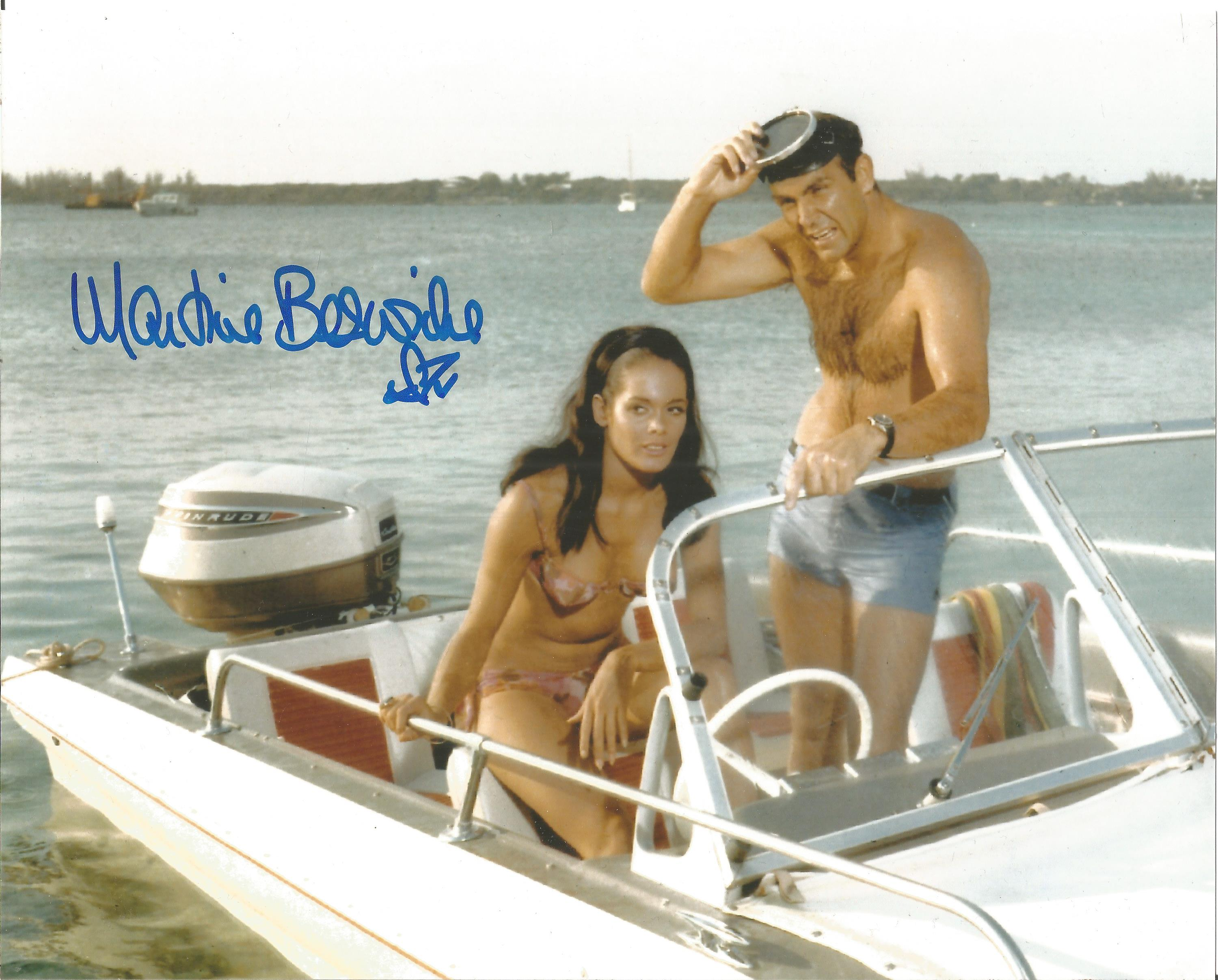 Martin Beswick signed 10 x 8 inch colour James Bond photo on boat with Sean Connery. Good condition.