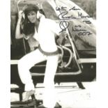 Caroline Munro as Naomi signed 10 x 8 inch b/w James Bond photo getting out of helicopter. Good