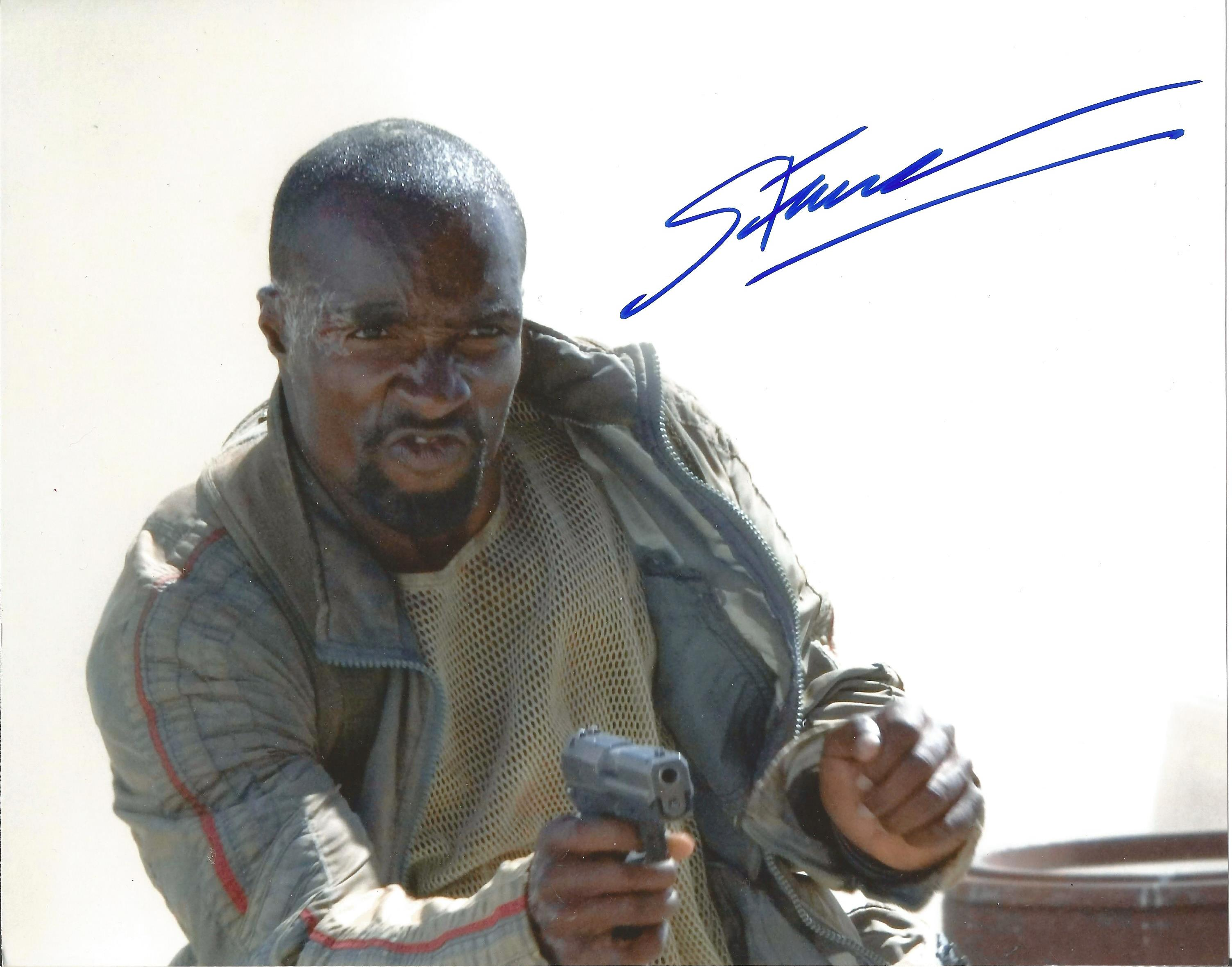 Sebastian Foucan signed 10x8 colour photograph pictured as hie plays his role of Mollaka in Casino