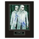 Stunning Display! The Matrix Twins hand signed professionally mounted display. This beautiful