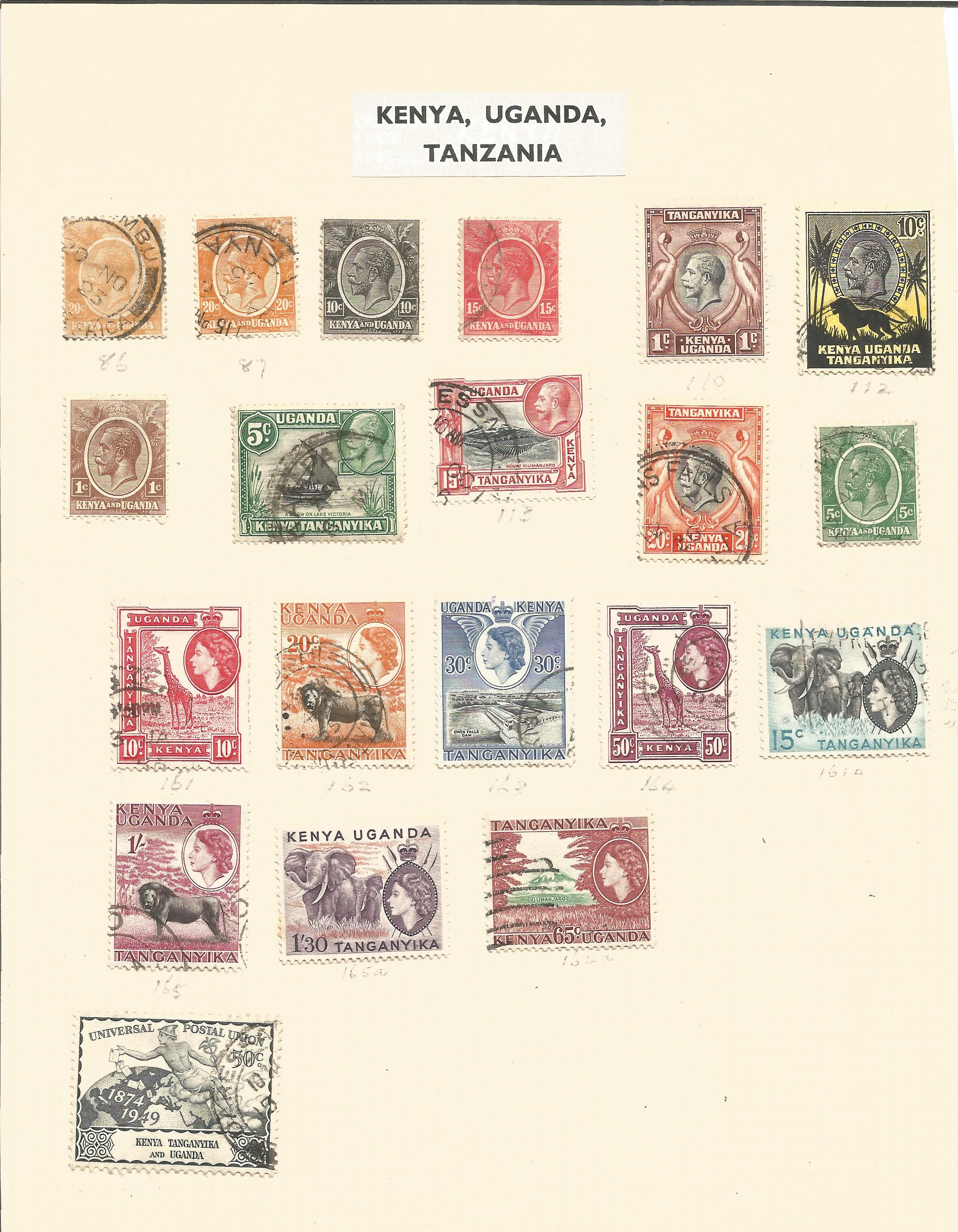 Kenya, Uganda and Tanzania stamp collection on 2 album pages. Good condition. We combine postage