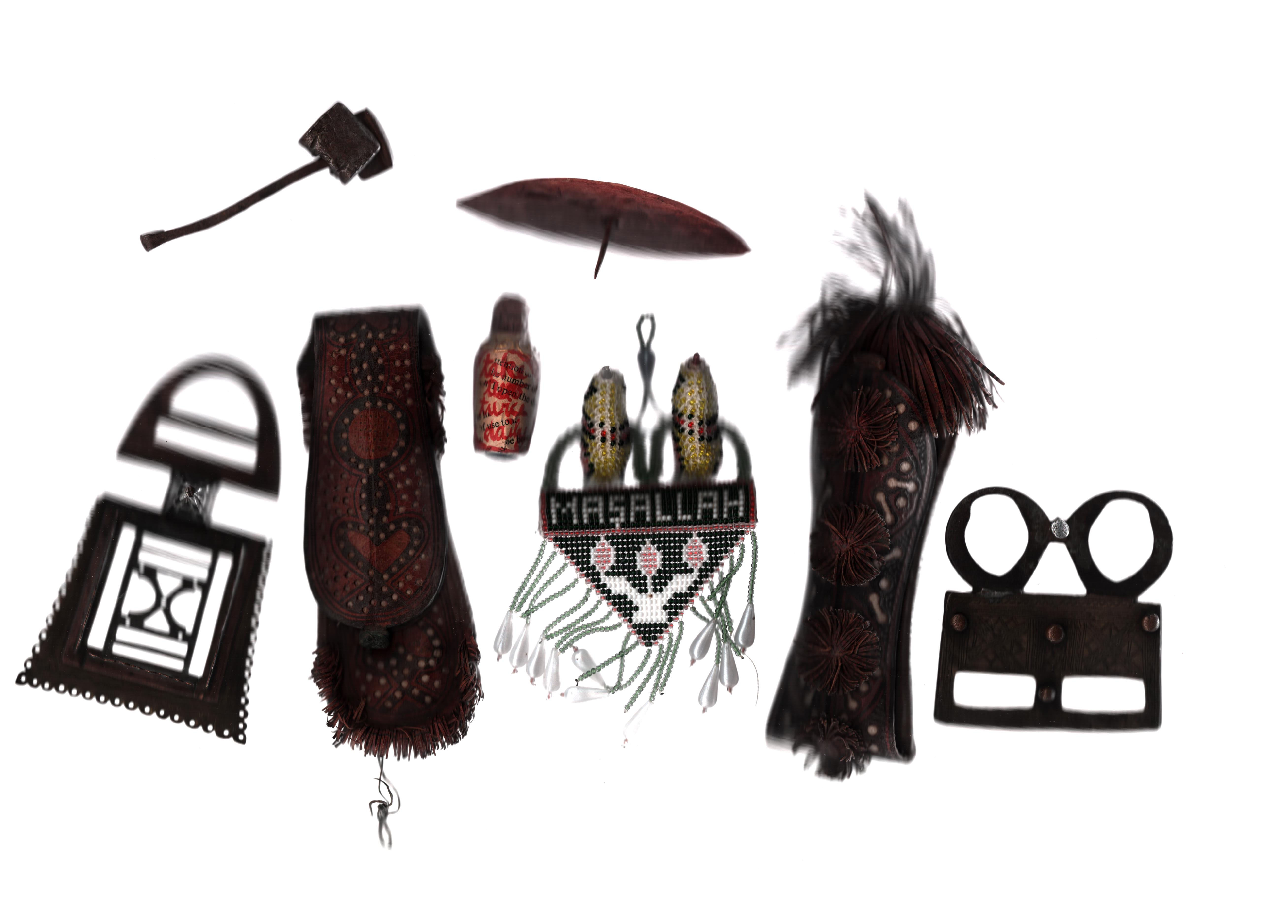 Tribal artefacts collection. 8 items assortment of metal, wood and leather. Good luck charms,