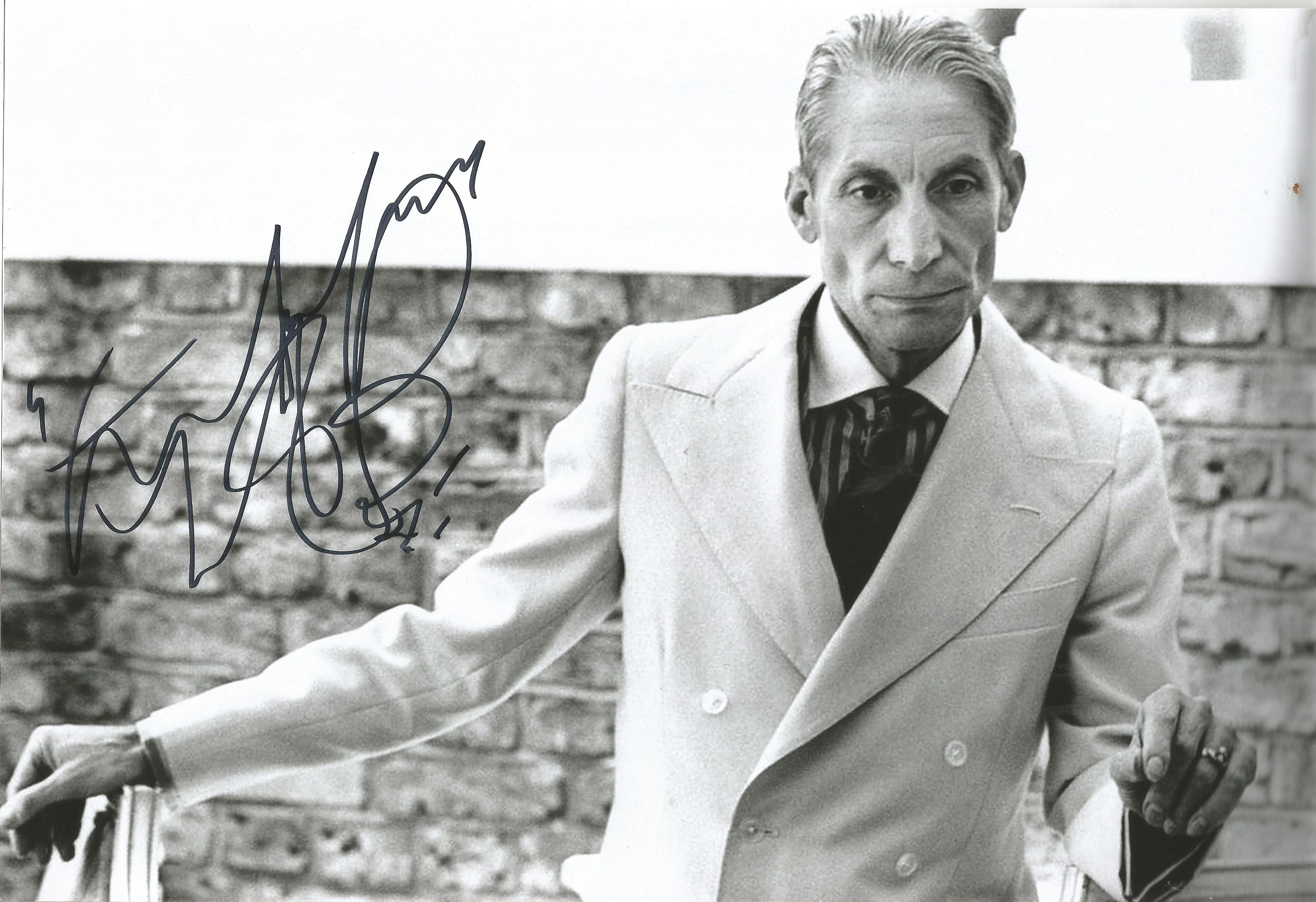 Charlie Watts signed 12x8 black and white photo. Good condition. All autographs come with a
