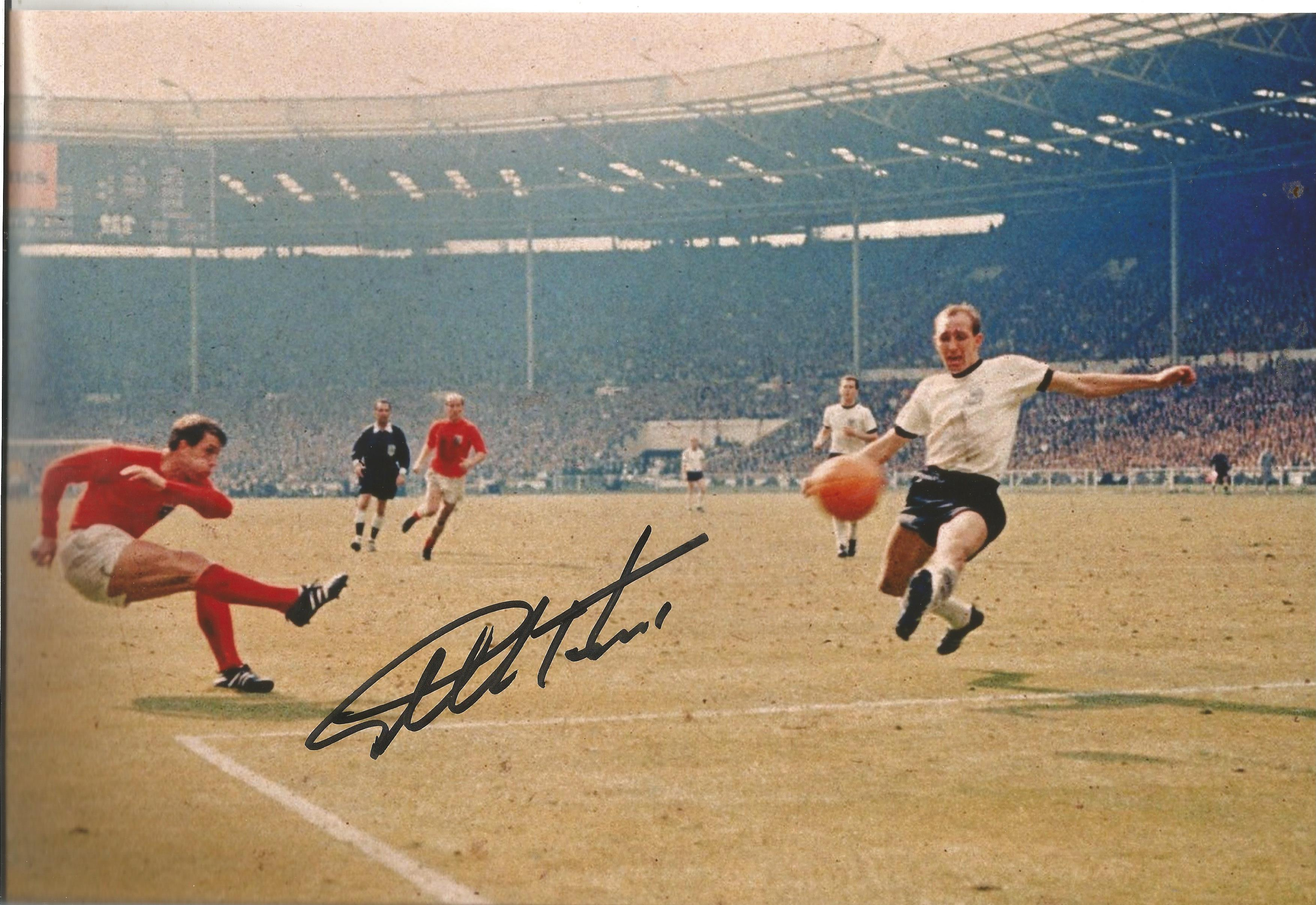 Sir Geoff Hurst signed 12x8 colour photo pictured in action during the 1966 world cup final. Good