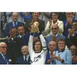 Franz Beckenbauer signed 12x8 colour photo pictured lifting the world cup for West Germany in