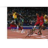 Usain Bolt collection 2 signed 16x12 colour photo. Usain St Leo Bolt, OJ, CD ( born 21 August