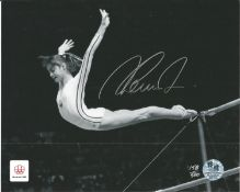 Gymnast Nadia Comaneci signed official Olympics 10 x 8 inch b/w photo flying through the air. Good