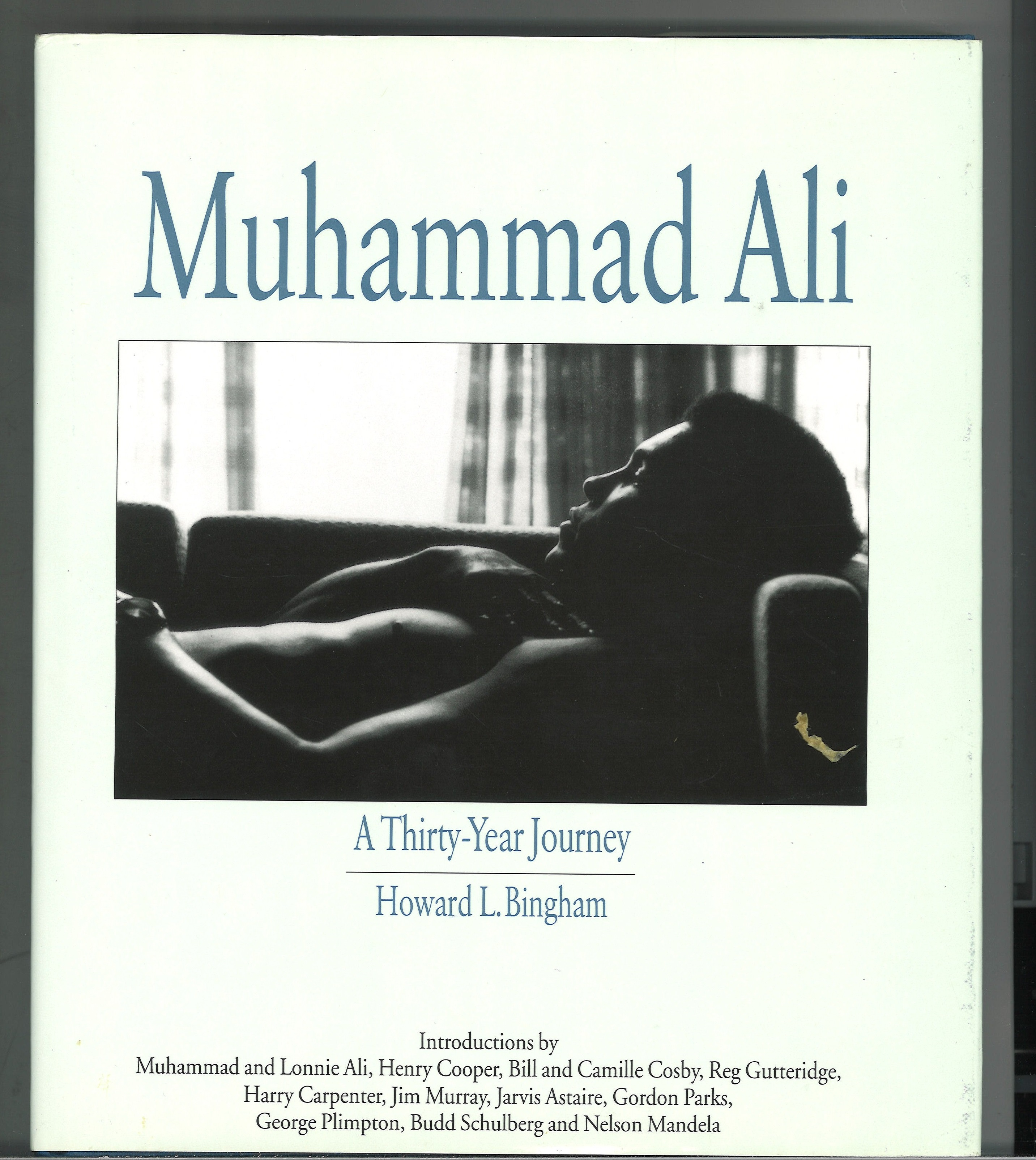 Muhammed Ali signed hardback book titled A Thirty Year Journey signed inside on a affixed