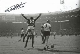 Football Geoff Hurst signed 12x8 black and white photo picture celebrating scoring in the 1966 World