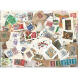 GB loose stamp collection on backing paper. Good condition. We combine postage on multiple winning