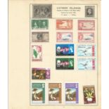 British Commonwealth stamp collection 5 loose album leaves from Ceylon and the Cayman Islands.