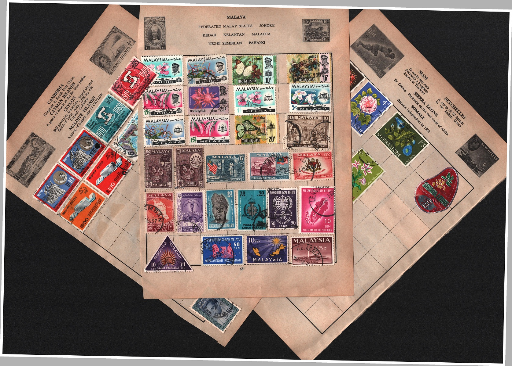BCW stamp collection on 13 loose pages. Includes Bermuda, Barbados, Ceylon, Malaya, Singapore and