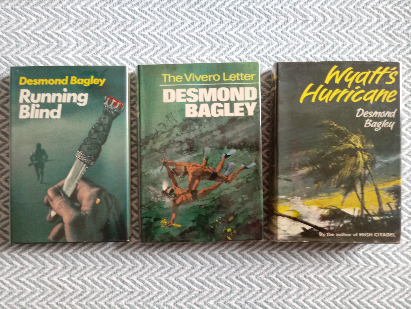 3 x Desmond Bagley hardback books published by Collins 1- Wyatt's Hurricane 287 pages 1966. In