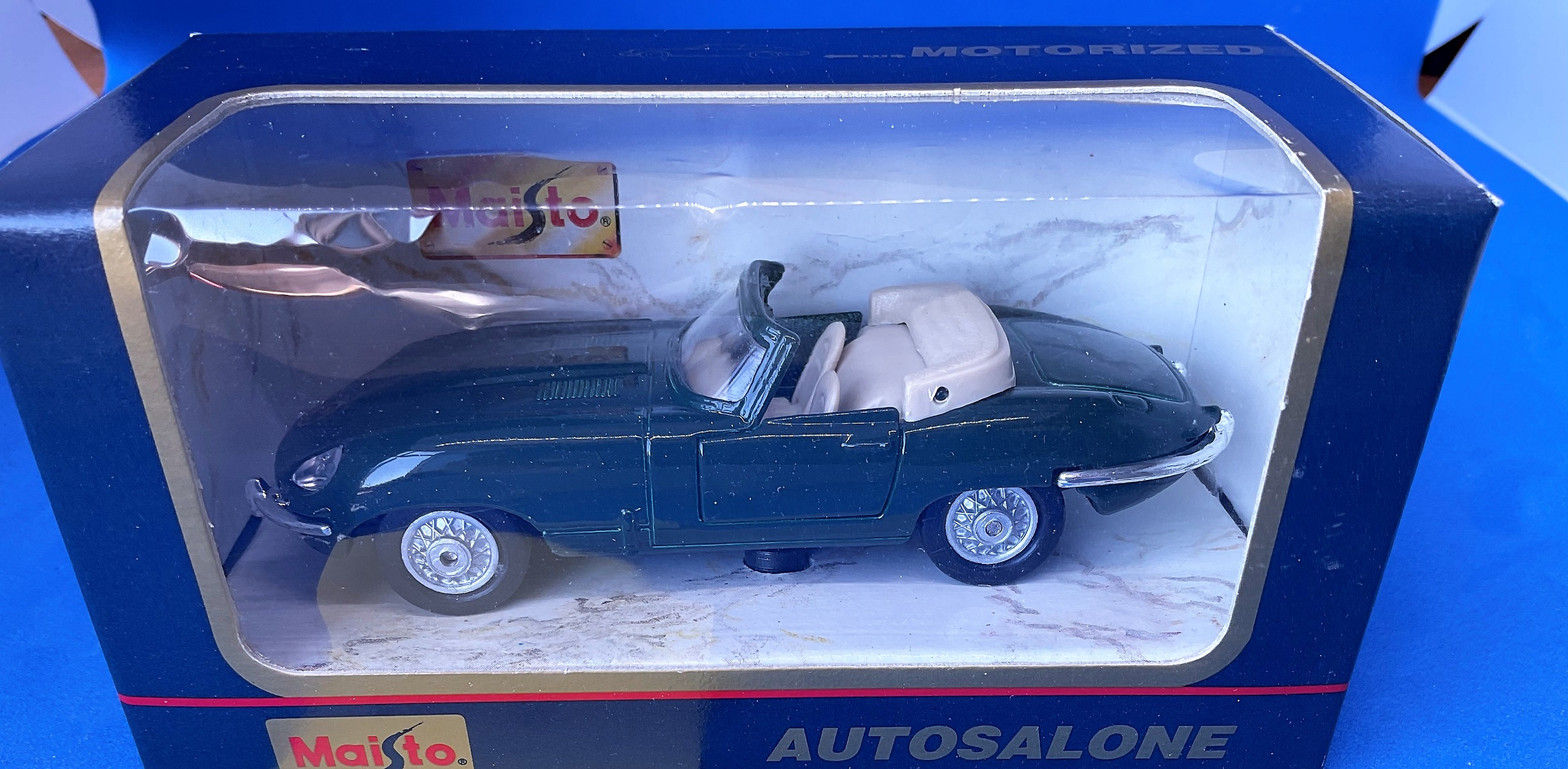 Vintage Toys. Autosalone. Jaguar. A Die-Cast and plastic pull back action car, with opening doors.