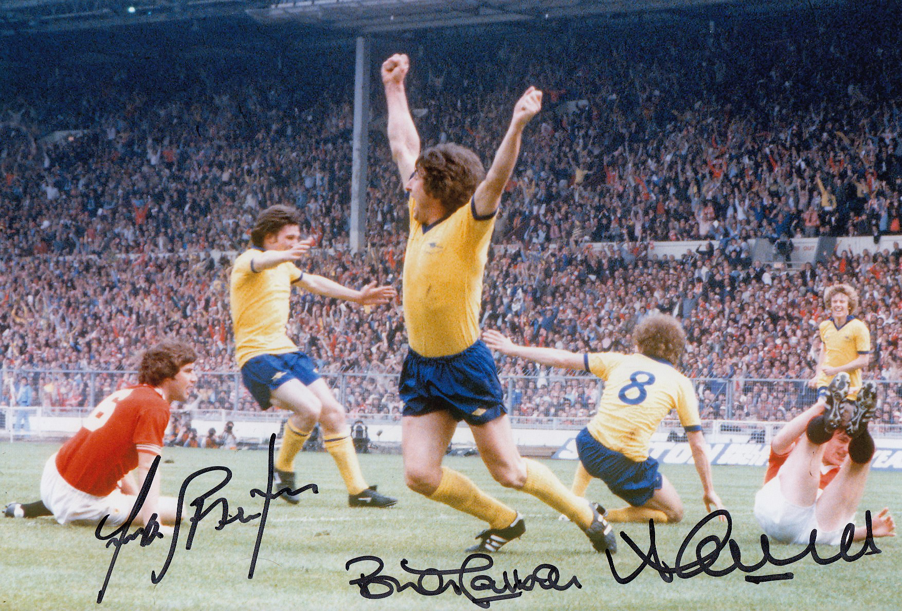Autographed ARSENAL 12 x 8 photo - Col, depicting Arsenal players celebrating after BRIAN TALBOT had